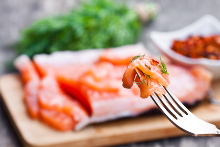 peace  of salted salmon with herbs