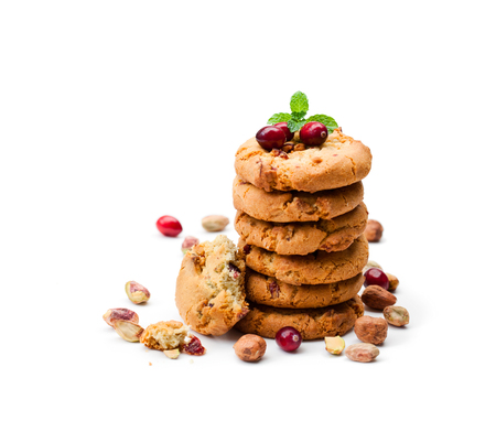 Stack  of oat cookies with cranberry and pistachio isolated on white
