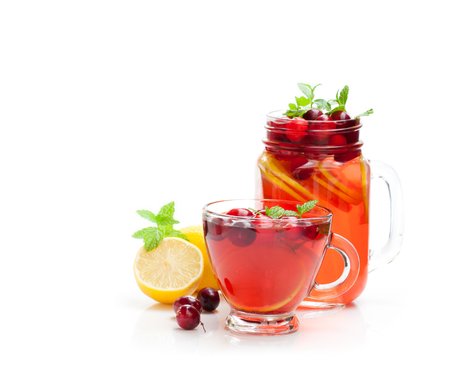 Red  fruit tea with lemon and cranberry isolated on white background  Stok Fotoğraf