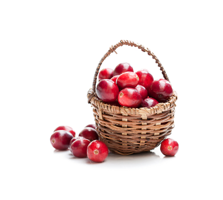 Fresh  cranberries in small wicker basket isolated on white background