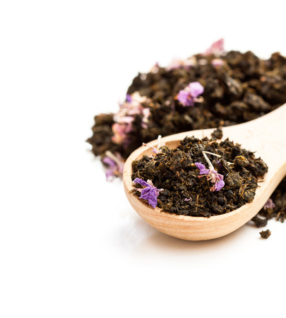 Black  tea with willow-herb isolated on white background