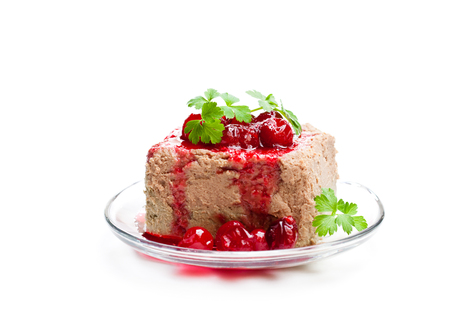 poultry  liver pate with cranberry sauce on a plate