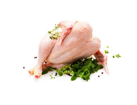 Raw  chicken with herbs and lemon isolated on white background  Stock Photo