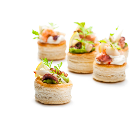Vol-au-vents  puff pastry cases filled with salted squid and octopus
