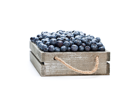 fresh  blueberries in a wooden box isolated on white background