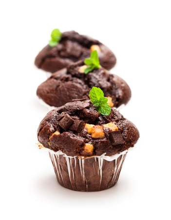 Triple  chocolate muffins isolated on white  Stock Photo