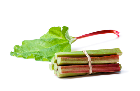 Bunch  of fresh rhubarb isolated on white