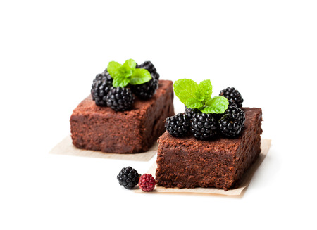 Chocolate  brownie pieces with blackberries isolated on white  Reklamní fotografie