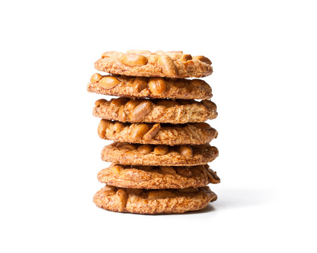 Stack  of sugar cookies with monkey nuts isolated on white  Stock Photo