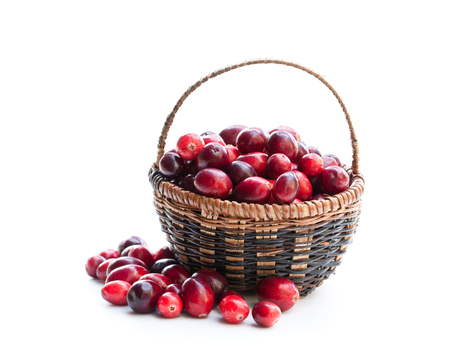 Fresh  cranberries in small wicker basket isolated on white Stock Photo