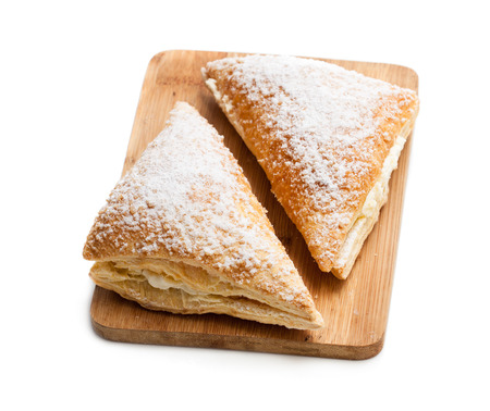 Two freshly baked turnovers with white cream isolated on white Reklamní fotografie