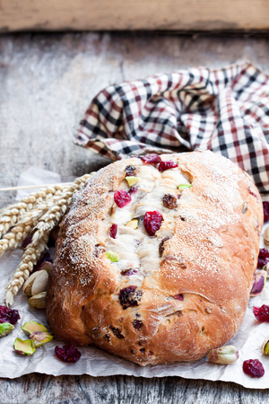 Homemade  mixed fruit and nut white bread on wooden table