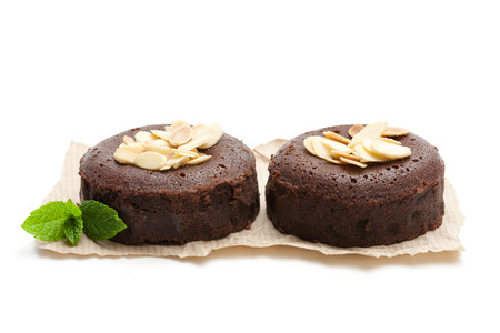 Chocolate  fondant with almonds isolated on white Фото со стока