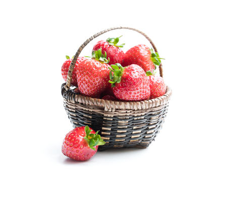 Strawberry  plant with berries in small basket isolated on white Reklamní fotografie