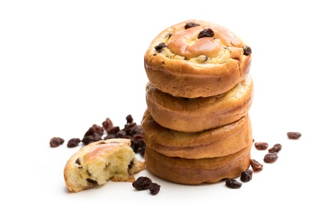 Stack  of raisin buns isolated on white