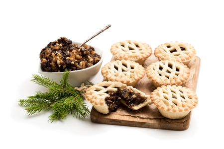 Mince pie group on cutting board isolated on white