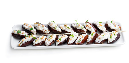 Dates  stuffed with cream cheese and almonds isolated on white 写真素材