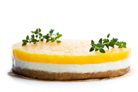 Healthy layered pineapple cheese cake isolated on white