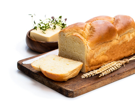 Homemade  brioche loaf with butter and herb isolated on white