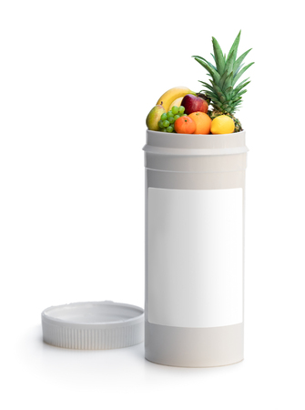 Swap your pills to a fresh fruits. Concept of nature made vitamin supplement from natural tropical fruits Foto de archivo
