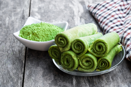 Matcha  green tea crepe on rustic wooden table