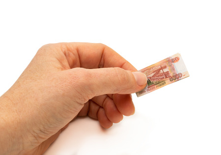 Finance concept hand holding inflated russian 5000 rubles bank note