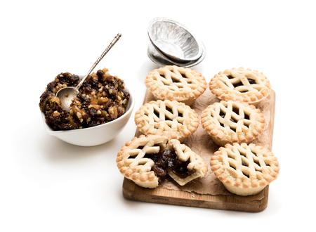 Mince  pie served on the wooden board isolated on white