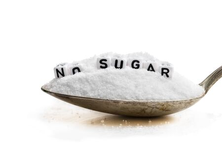 Spoon  full of sugar substitute stevia. No sugar concept
