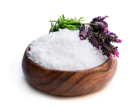 Lavender salt in wooden bowl isolated on white