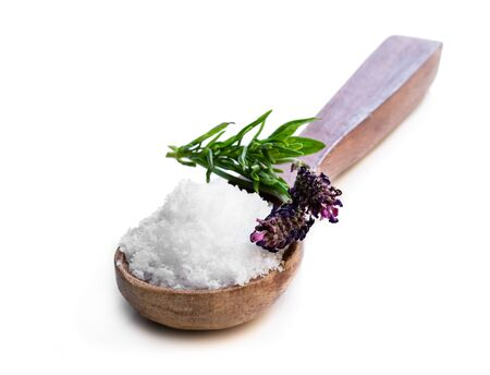 Lavender salt in wooden spoon isolated on white