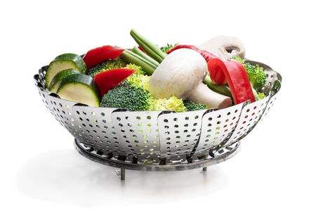 Fresh raw vegetables in steam basket. Ready for cooking.