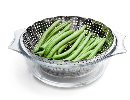 Fresh raw beans in steam basket. Ready for cooking.