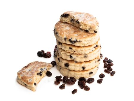 Stack of iced Welsh cakes with raisins isolated on white Stock Photo