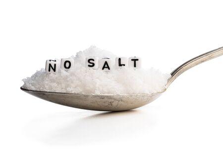 Spoon full of sea salt. No salt concept