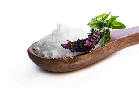 Brown  wooden spoon full of sea salt with lavender isolated on white