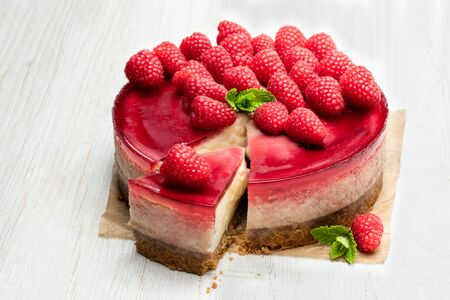 Homemade  cheesecake with raspberry jelly isolated on white