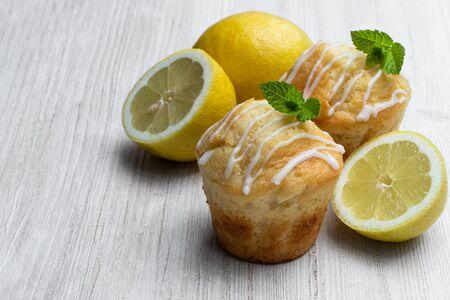 Homemade  lemon muffins on white wooden table