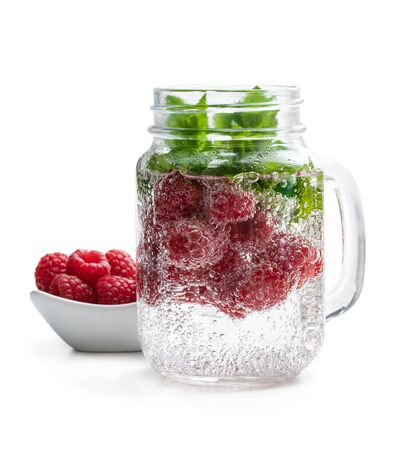 Homemade  raspberry and mint drink in glass jar isolated on white