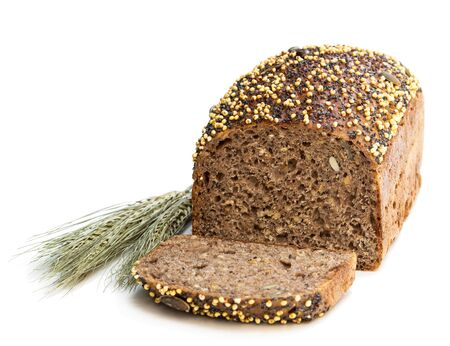 Homemade  wholemeal rye bread with chia seed and millet groats isolated on white Imagens