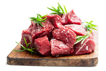 Sliced  raw beef with tarragon herb isolated on white Imagens