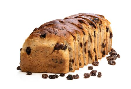 Sliced  Irish fruit loaf with sultanas and cherries isolated on white Imagens