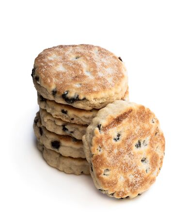 Stack  of iced Welsh cakes isolated on white