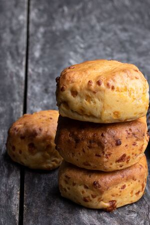 Homemade  cheese scones on wooden table