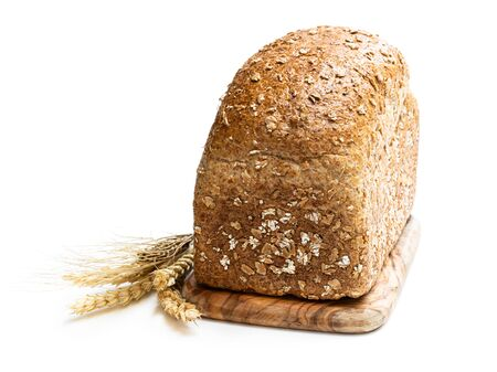 Homemade  wholemeal rye bread with pearl barley isolated on white Imagens