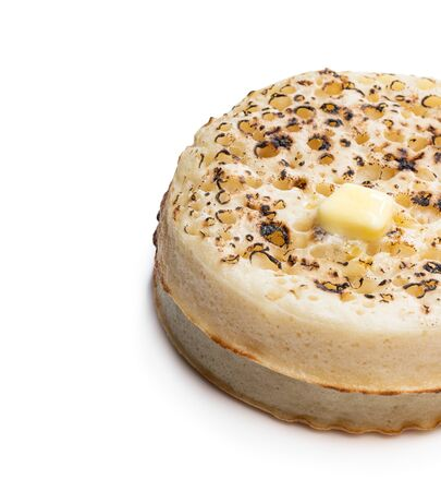 Stack  of wholemeal crumpets isolated on white