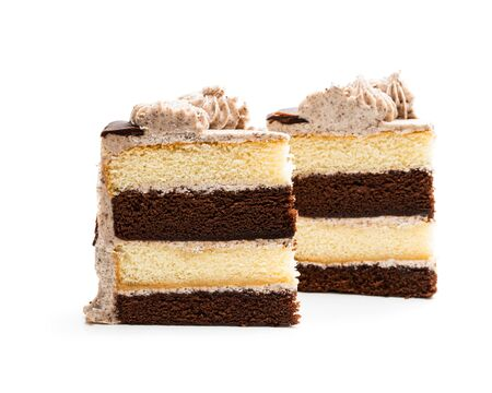 Pieces  of layered sponge cake with cookie crumb isolated on white  Imagens