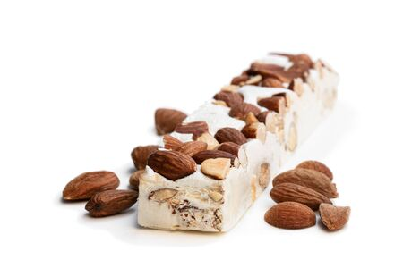 Homemade  nougat bar with almonds isolated on white