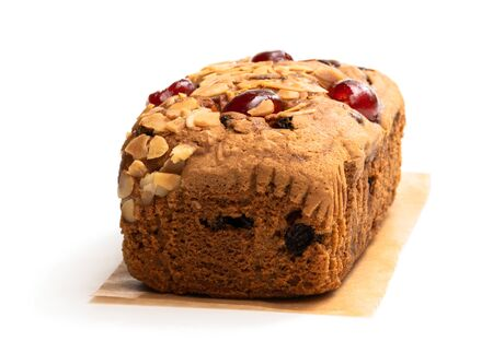 Mixed  fruit loaf cake with almond flakes isolated on white
