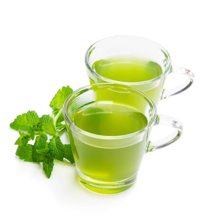 Green mint tea in clear glass cups isolated on white Banco de Imagens
