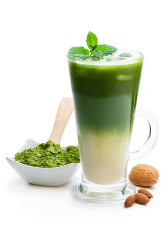 Homemade layered iced matcha latte tea with almond milk isolated on white